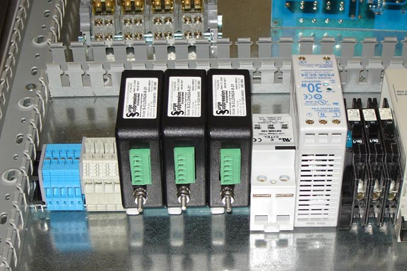 Cabinet with Multiple High Performance Data Line Surge Protectors. DIN Rail Mounted For Easy Installation. Get the Right Gear!